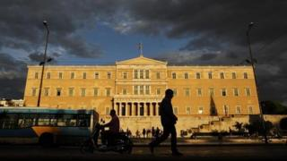 A man walks past the Greek parliament