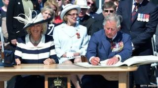 Camilla, Duchess of Cornwall, and Charles, Prince of Wales, sign Canada's golden book in New Brunswick in 2012