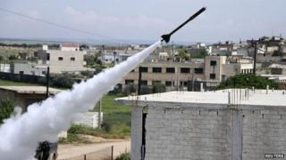Free Syrian Army fighters launch a homemade rocket at regime forces - 10 April 2014