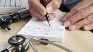 A close-up shot of a doctor writing a prescription