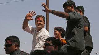 Rahul Gandhi waves to supporters, with his sister Priyanka Vadra seated by his side, in Amethi, on Saturday, April 12, 2014