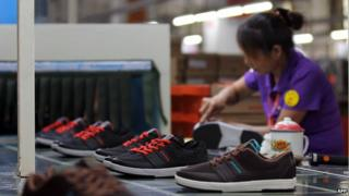 A labourer works in a shoe factory in Jinjiang, south China's Fujian province, 17 September 2013