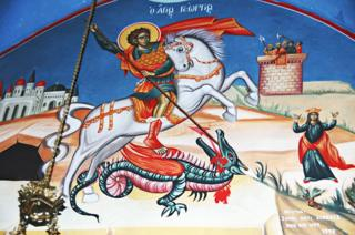A painting of St George spearing a dragon