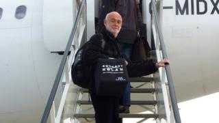Peter Hodes boarding a plane