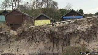 Beach huts left close to the shoreline after winter storms