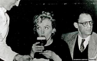 Marilyn Monroe (drinking Guinness) and Arthur Miller
