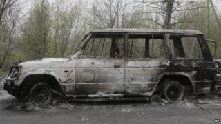 Burnt out cars after a night fight at the check point which was under the control of pro-Russian activists in the village of Bulbasika near Slovyansk, Ukraine, Sunday, April 20, 2014.