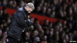 David Moyes standing on the touchline with his head down and arms folded