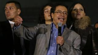 In this March 19, 2014, file photo, Bogota Mayor Gustavo Petro speaks to supporters from a balcony of the city hall in Bogota, Colombia.