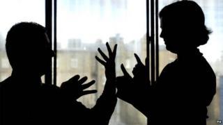 Two people using sign language
