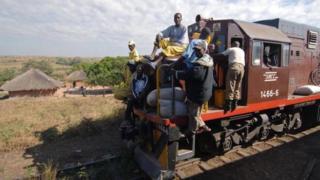 A freight train carrying passengers near Kabongo in DR Congo - 2007
