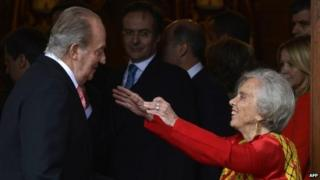 Spanish King Juan Carlos greets Mexican journalist Elena Poniatowska prior a ceremony to present her the 2013 Cervantes Prize Literature prize at Alcala University in Madrid on 23 April, 2014