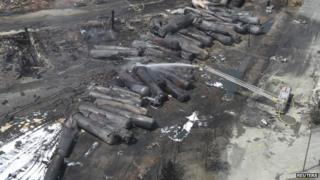 An aerial view of burnt train cars after a train derailment and explosion in Lac-Megantic, Quebec 8 July 2013