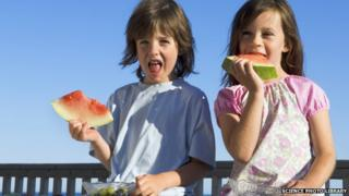 Children eating water melon
