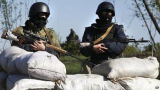 Ukrainian troops guard a checkpoint near village of Dolyna. 26 April 2014