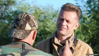 Chris Packham with a hunter