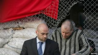 Detained international observer (R) leaves mayor's office in Sloviansk with OSCE official (L) 27/04/2014