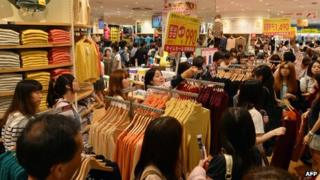 Consumers at a shop in Japan