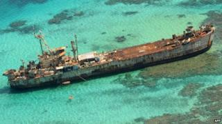 In this photo taken on 29 March 2014, an aerial view shows a Philippine navy vessel that has been grounded since 1999 to assert the nation's sovereignty over the Second Thomas Shoal, a remote South China Sea reef also claimed by China