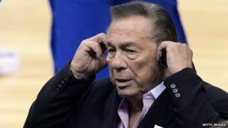 Los Angeles Clippers owner Donald Sterling stands courtside at an NBA game.