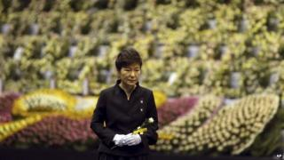 South Korean President Park Geun-hye pays tribute to the victims of the sunken ferry Sewol at a group memorial altar in Ansan, south of Seoul, South Korea, on Tuesday, 29 April, 2014