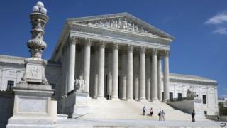 People walk on the steps of the US Supreme Court in Washington on 26 April 2014