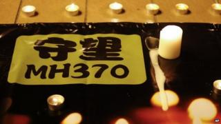 A banner is displayed during a candlelight vigil for passengers onboard the missing Malaysia Airlines Flight MH370, in Kuala Lumpur, Malaysia, on 7 April 2014