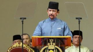 Brunei's Sultan Hassanal Bolkiah delivers a speech during the official ceremony of the implementation of Sharia Law in Bandar Seri Begawan on 30 April 2014
