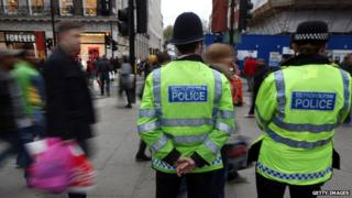 Police patrol Oxford Street, London