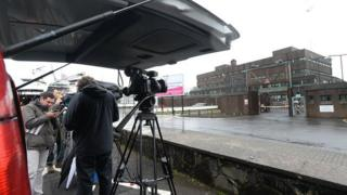 The media have gathered at Antrim police station