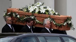 Sue Townsend's casket carried out of the theatre