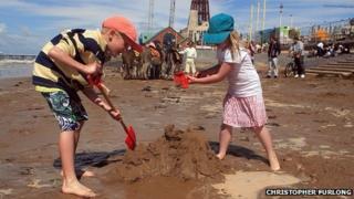 Children play on Blackpool beach