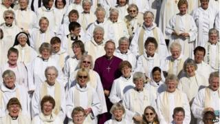 Justin Welby with a large number of female priests