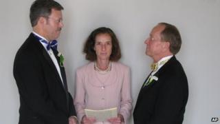 Mark Andrew, left, and Bishop Gene Robinson marry in a civil ceremony in Concord, NH (7 June 2008)