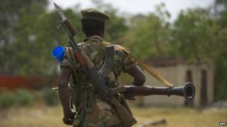 South Sudanese People Liberation Army (SPLA) soldier patrols in Malakal on 21 January 2014