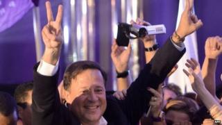 Panamanian presidential candidate for the Panamenista party (PP), Juan Carlos Varela, flashes the V sign after winning the presidential election in Panama City, on May 4, 2014.