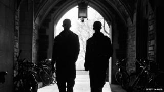 Two men walk through a tunnel on the Princeton University campus.