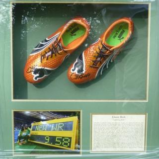 Signed and framed Usain Bolt running shoes