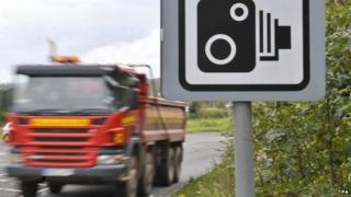 Lorry passes speed camera sign