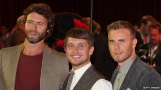 (l-r) Howard Donald, Mark Owen and Gary Barlow at a London film premiere in 2011