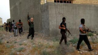 Militants on patrol in Falluja, April 2014