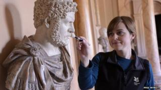 A Roman statue being cleaned