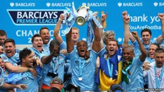 Vincent Kompany of Manchester City lifts the Premier League trophy at the end of the Barclays Premier League match between Manchester City and West Ham United