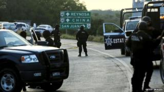 Mexican security forces blockade the road between the cities of Monterrey and Reynosa on 13 May, 2012.
