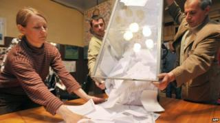 Ballot papers being emptied onto table