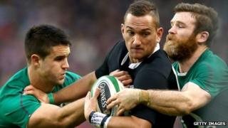 Aaron Cruden of world champions New Zealand is tackled by Conor Murray (L) and Gordon D'Arcy (R) of Ireland