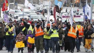"""Members of the """"Omushkegowuk Walkers"""" and their supporters march towards Parliament Hill 24 February 2014"""