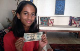 Laila Alva with the $20 note