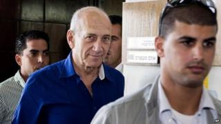 Ehud Olmert leaves the Tel Aviv District Court on 13 May 2014