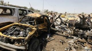 Aftermath of car bomb in Baghdad (13 May 2014)